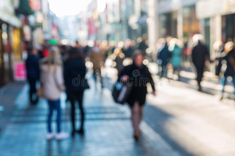 Crowd of people on a shopping street royalty free stock photo