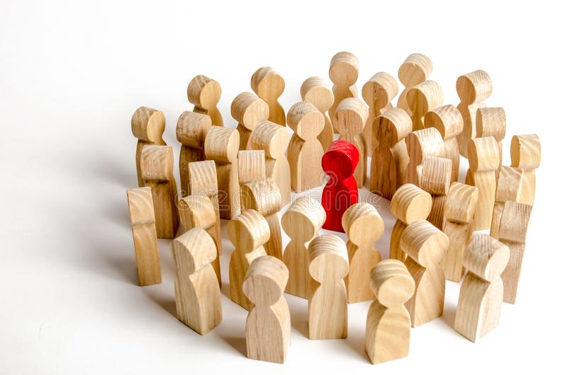 A crowd of people surrounded the red man. Accusation of crime, mob law over a person, lynch court. The leader in the center. Of the crowd, the leader, an royalty free stock image