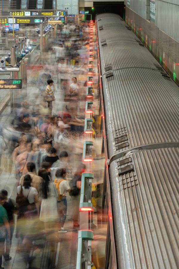 Crowd of people with the trains in underground railway tunnel. Subway metro in transportation background in Taipei City, Taiwan royalty free stock photography