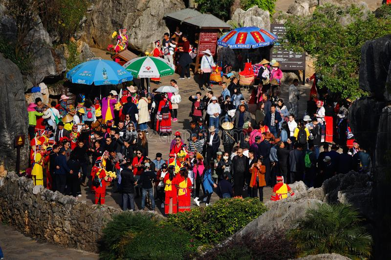 Crowd of people visiting the Stone Forest in Yunnan, China. Crowd of people visiting the Stone Forest in Yunnan. Yunnan, China - November, 2018 royalty free stock photography