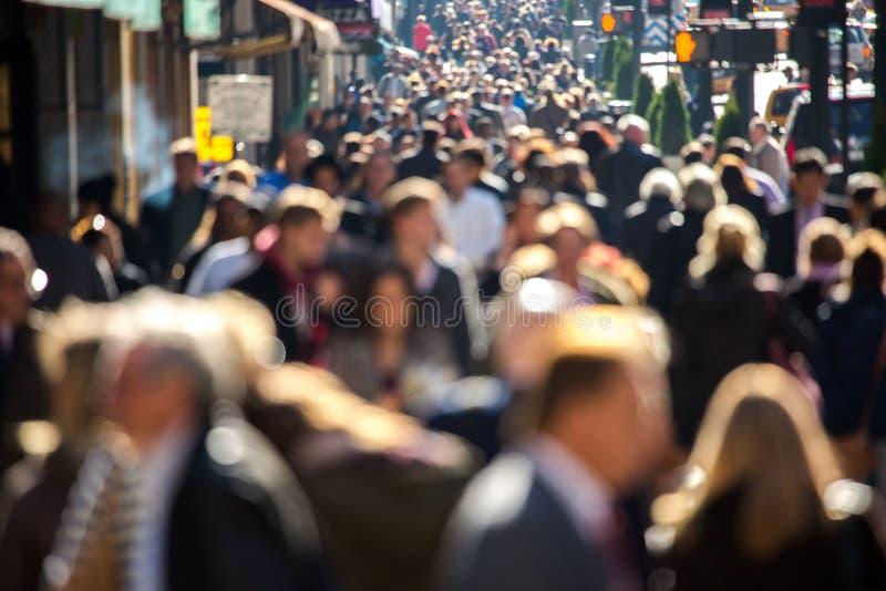 Crowd of people walking on city street stock photos