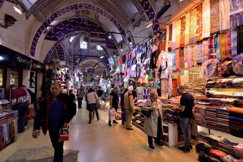 A crowd of people walking inside the Grand Bazaar in Istanbul, Turkey. stock photos