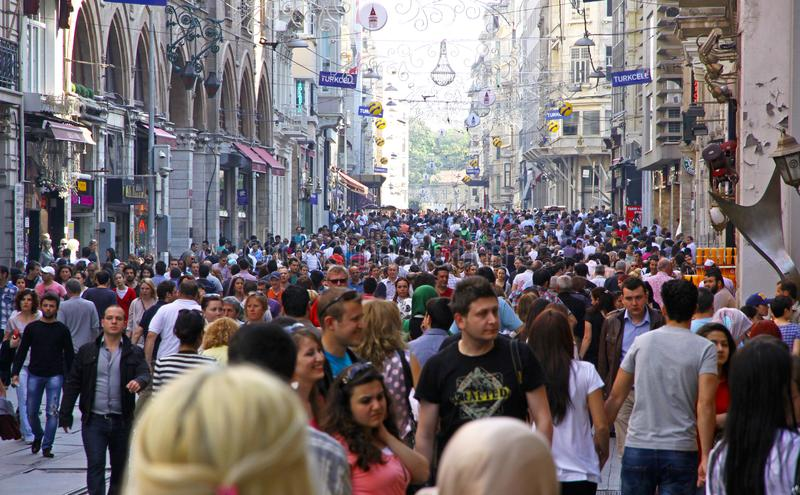 Crowd of people walking on Istiklal street in Istanbul, Turkey. People walking on Istiklal street in center of Istanbul city, Turkey. The most famous street in stock photo