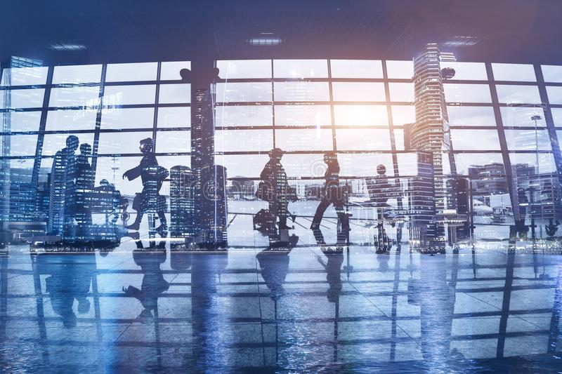 Crowd of people walking in modern airport stock photo
