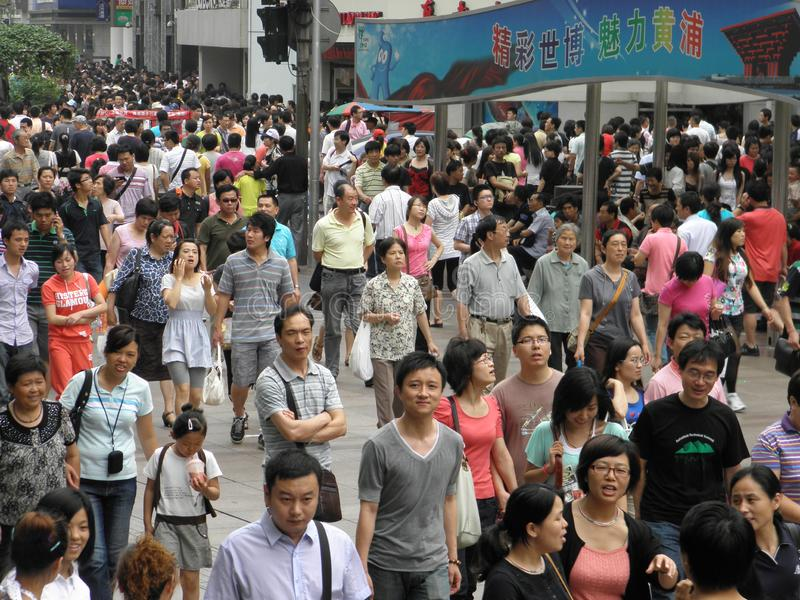 A crowd of people walking in Shanghai, China. This is crowd of people enjoying a weekend afternoon walk in Shanghai, China royalty free stock image