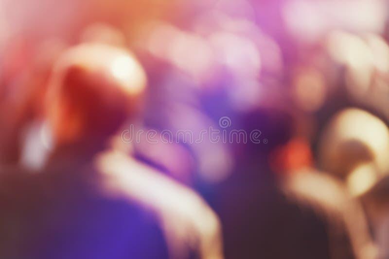 Crowd of People Walking On the Street in Bokeh stock photos
