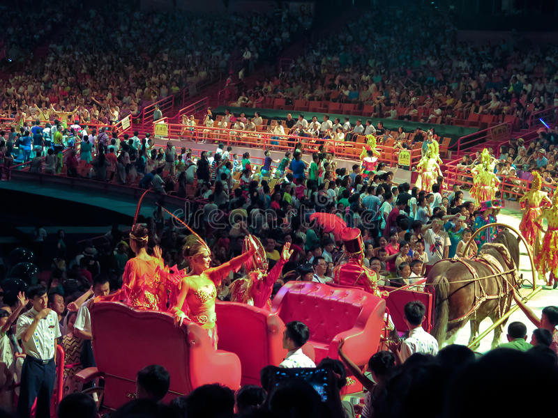 Crowd of people watch circus performance stock photo