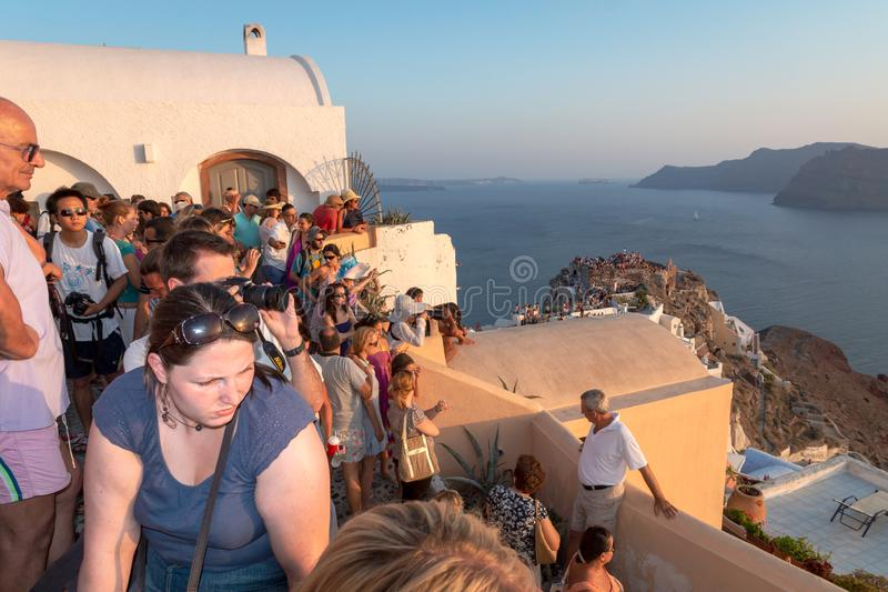 Crowd of people watching the famous Santorinian sunset royalty free stock photo