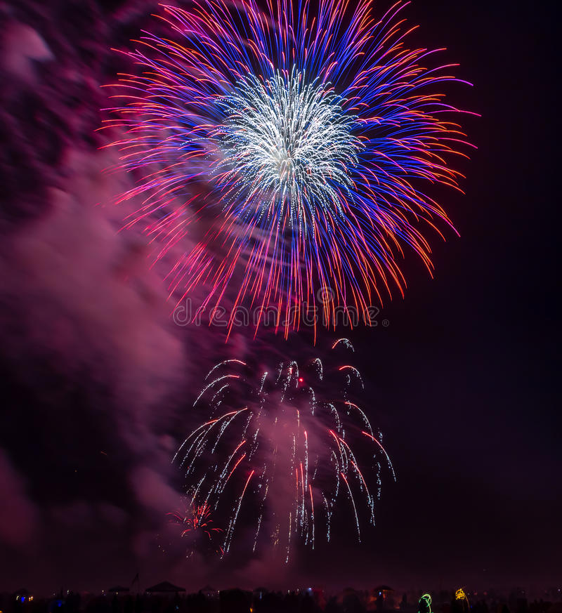 Crowd of people watching fireworks display on the beach Seaside Oregon stock photos
