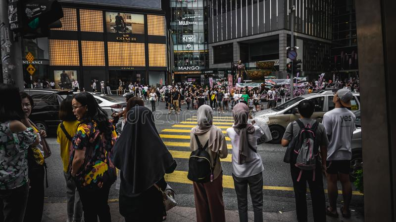 Crowd of peoples crossing the road at yellow lines at Bukit Bintang. stock photography
