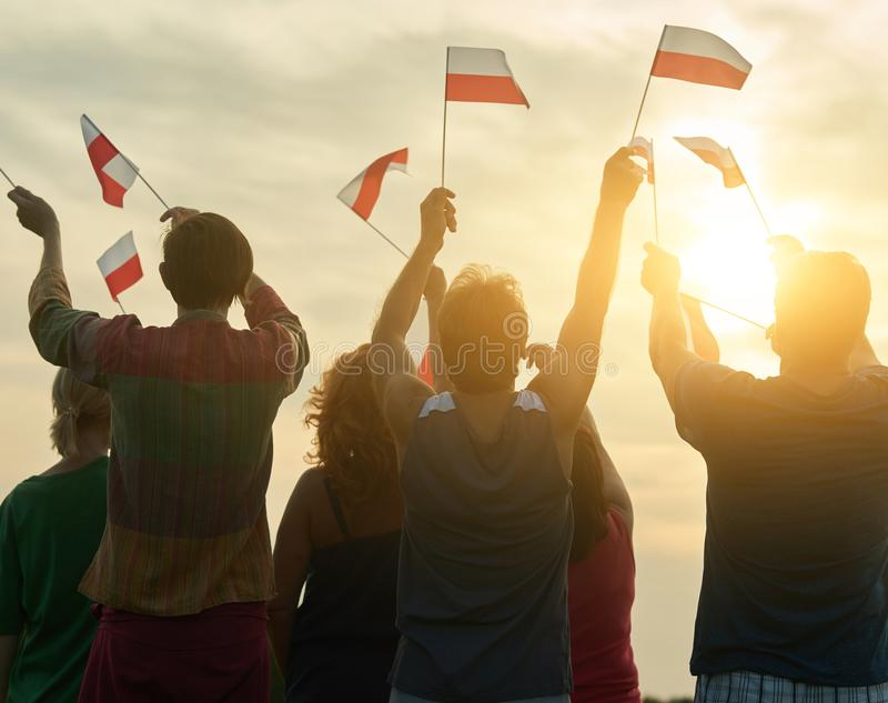 Crowd with polish flags. People with poland flags, down sky background stock photography