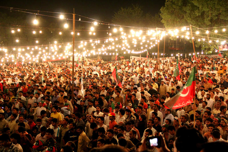 Crowd at Political Rally. GUJRANWALA, PAKISTAN - SEPT. 25: Large crowd of people listening to Imran Khan at a political rally of Pakistan Tehreek-e-Insaf on royalty free stock photos