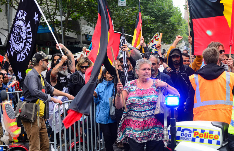 Crowd protest. Crowdsrepresenting aboriginal community protesting Australia national day celeberations