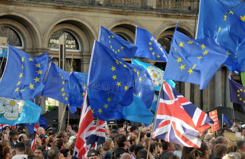 A crowd of protesters waving flags at the leeds for europe anti brexit demonstration. Leeds, west yorkshire, united kingdom - 29 august 2019: a crowd of stock photos