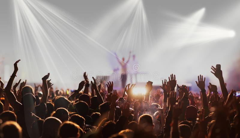 crowd with raised hands at concert festival banner royalty free stock image
