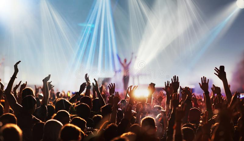 crowd with raised hands at concert festival banner royalty free stock photo