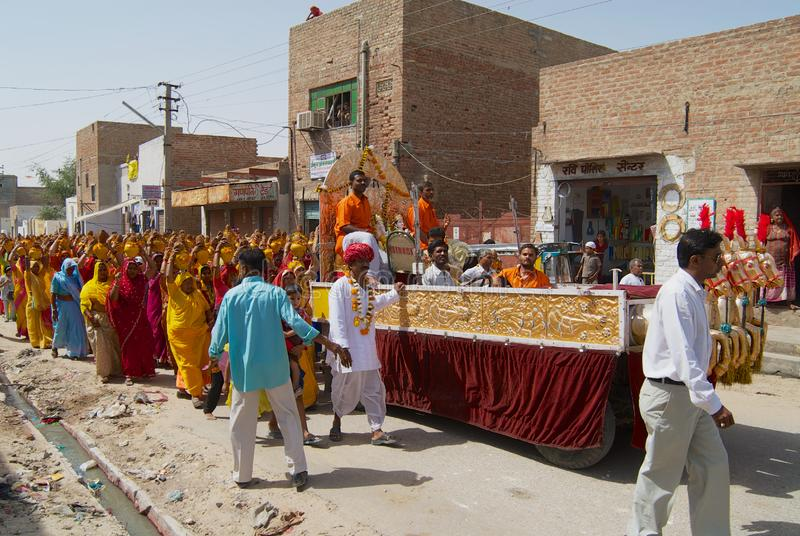 A crowd of Rajasthani people take part in a religious procession in Bikaner, India. stock photo