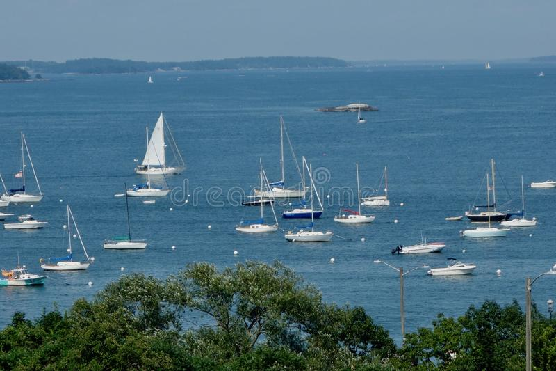 A crowd of sailboats in Portland Harbor, Maine, from above stock photography