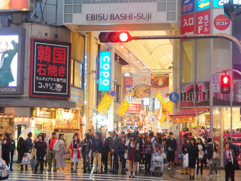 Crowd of shoppers on the busy street in Osaka shopping center. Crowd of shoppers on the busy street of Osaka in the evening. October 16, 2017 stock image