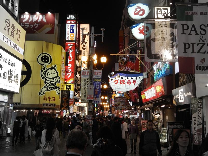 Crowd of shoppers in street at night in Osaka shopping center, Japan. Crowd of shoppers on the busy street of Osaka in the evening. October 16, 2017 royalty free stock photography