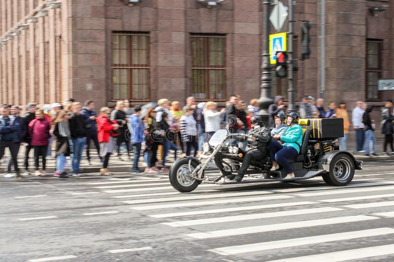 A crowd of spectators of a motorcycle parade at the transition stock photo