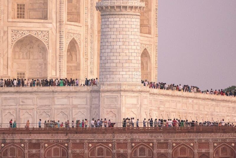 Crowd at Taj Mahal. A crowd waits in line to enter the mausoleum inside the Taj Mahal. Agra. India
