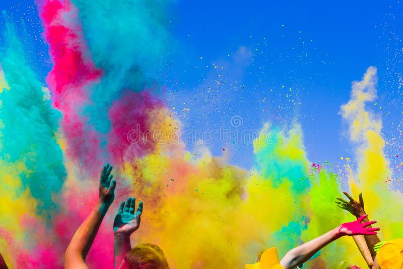 Crowd throws colored powder at holi festival stock photo