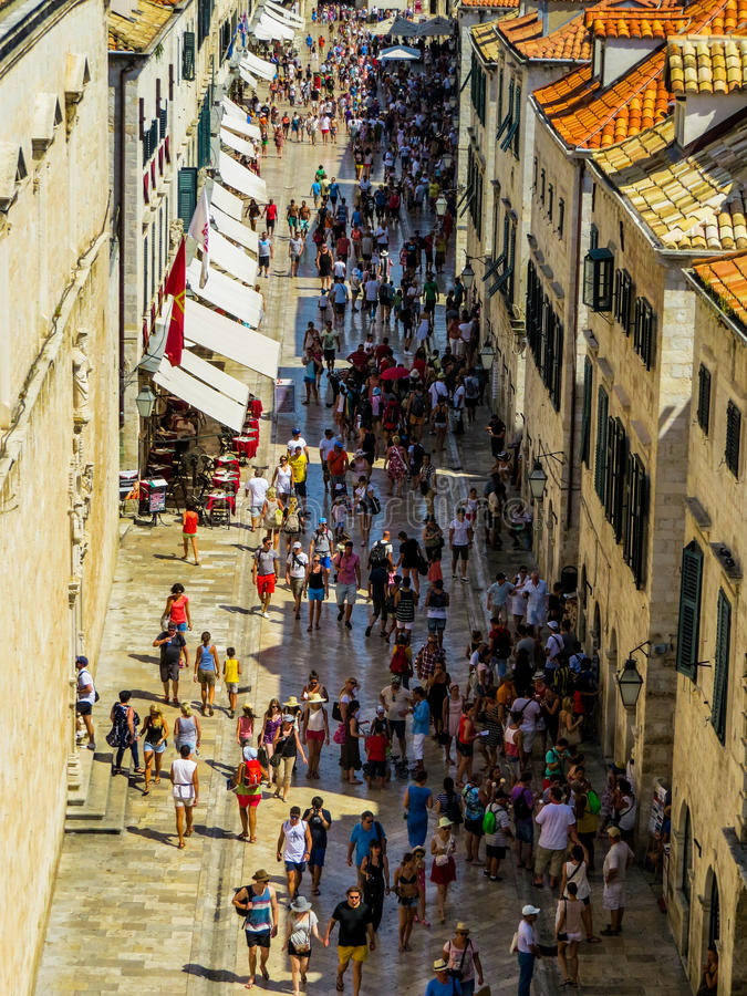 Tourists in Dubrovnik, Croatia. Stradun or Placa, the pedestrian main street crowded by tourists and locals in Dubrovnik, Croatia