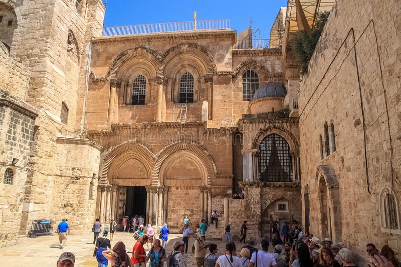 Crowd of tourists gather at the Church of the Holy Sepulcher in old meets new scene royalty free stock images