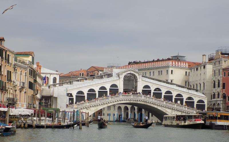 Crowd of tourists over the Rialto Bridge in Venice, Italy royalty free stock image