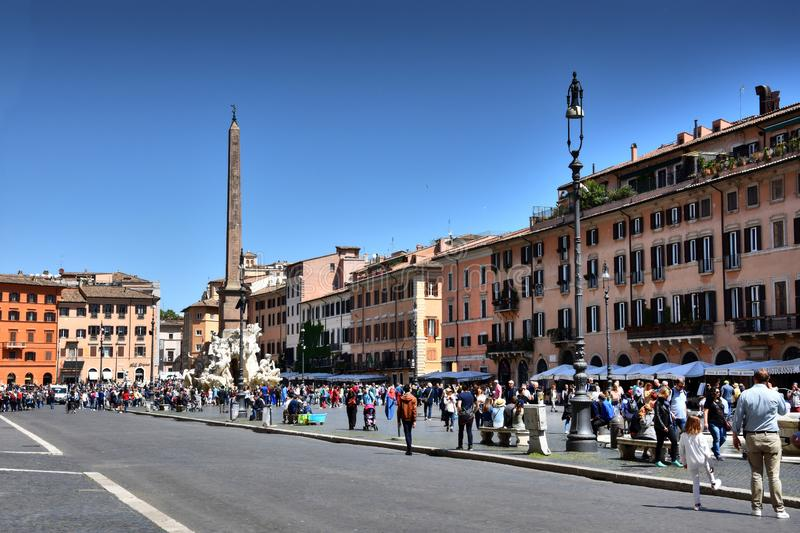Crowd of tourists at Piazza Navona in Rome, Italy. People visiting Piazza Navona with famous Bernini fountain in Rome, Italy stock image
