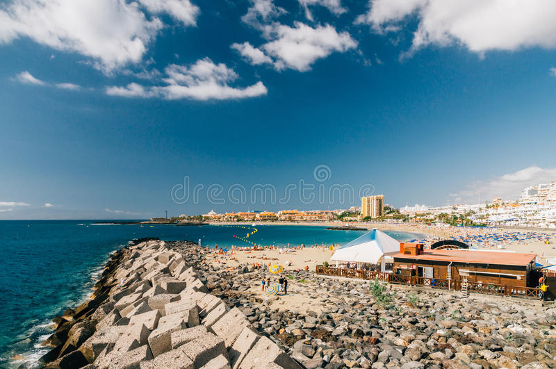 Crowd of tourists on the Playa de Las Vistas beach royalty free stock photography