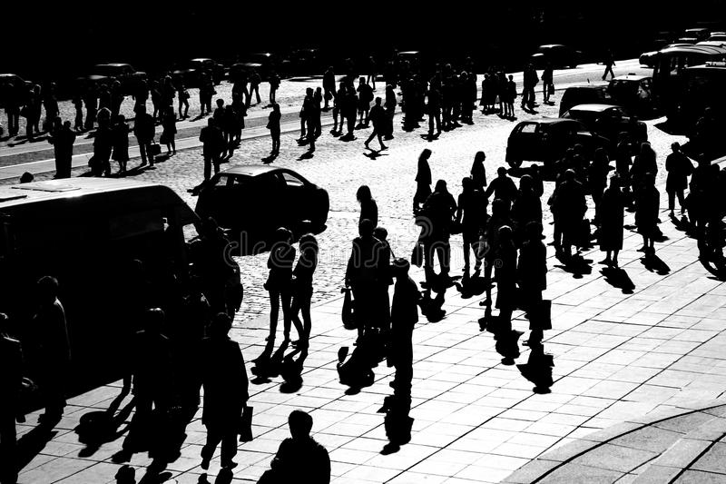 Crowd in town, city shadows royalty free stock images