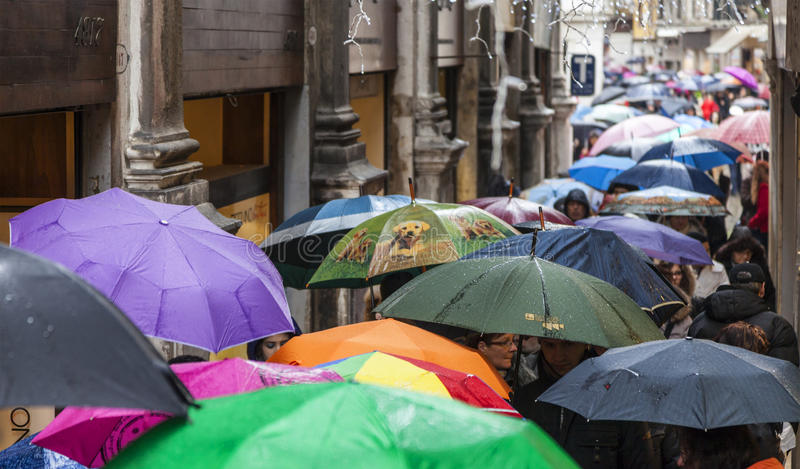 Crowd of Umbrellas in Venice stock images