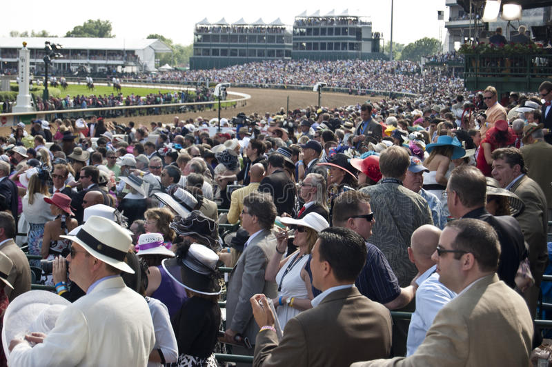 Crowd Watches the Kentucky Derby Race stock photos