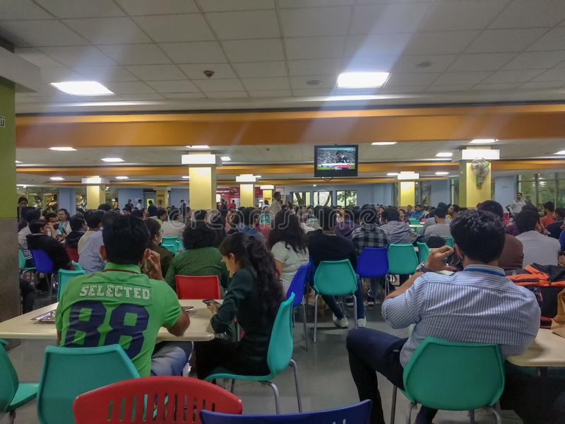 Crowd watching cricket match. A picture of crowd watching cricket match in office canteen royalty free stock photography