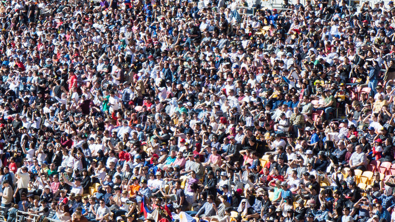 Crowd Watching An Event. A large crowd in a stadium watching an event or a sports royalty free stock photography