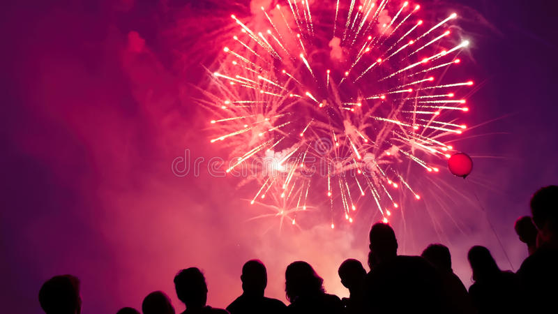 Crowd watching fireworks. And celebrating royalty free stock images