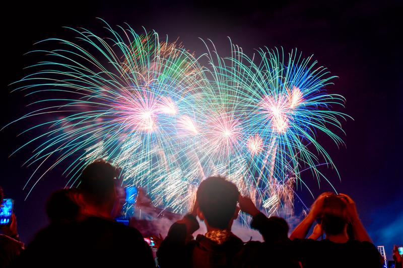 Crowd watching fireworks and celebrating city founded. royalty free stock images
