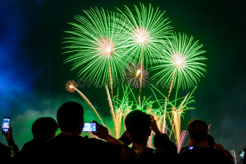 Crowd watching fireworks and celebrating city founded. royalty free stock photo