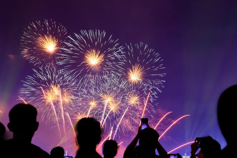 Crowd watching fireworks and celebrating city founded. Beautiful colorful fireworks display in the urban for celebration on dark royalty free stock photo