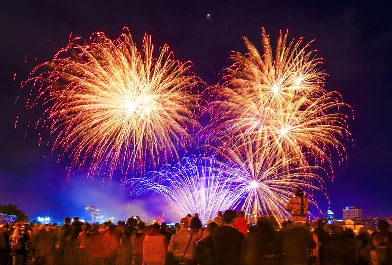 Crowd watching fireworks and celebrating. city holiday scene with fireworks royalty free stock photography
