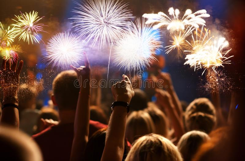 crowd watching fireworks - New Year celebrations- abstract holiday background stock image