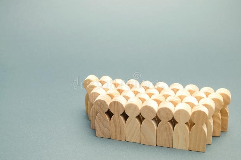 The crowd of wooden figures of people. Concept of business team. Labor collective. Teamwork. Employees. Human Resource Management. Labor market. Demographic stock photography