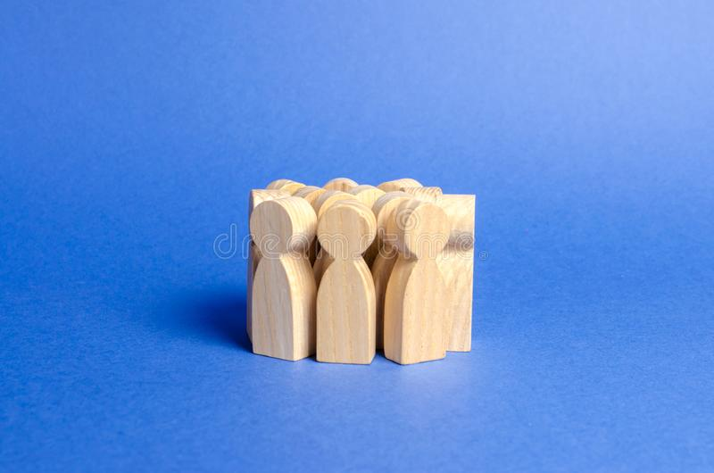 A crowd of wooden figures of people. Social survey and public opinion, electorate. Population and citizens. Society, social group royalty free stock photos