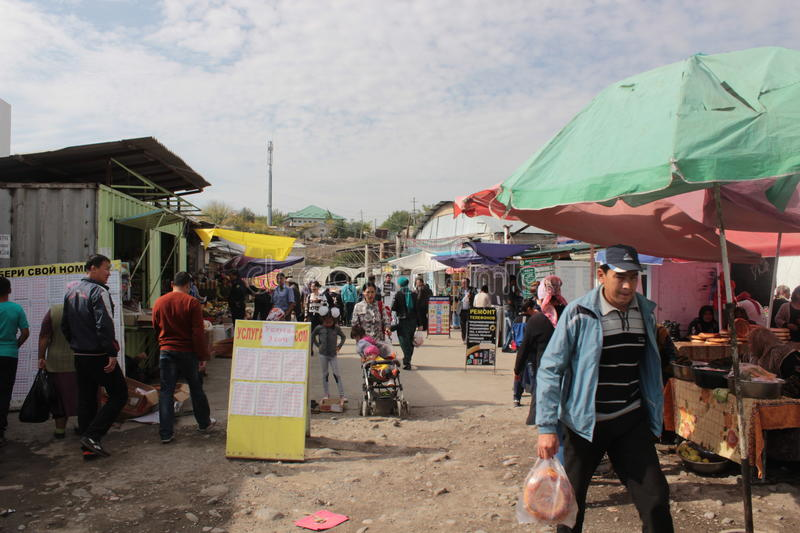 Crowded alley in Osh Bazaar stock photography
