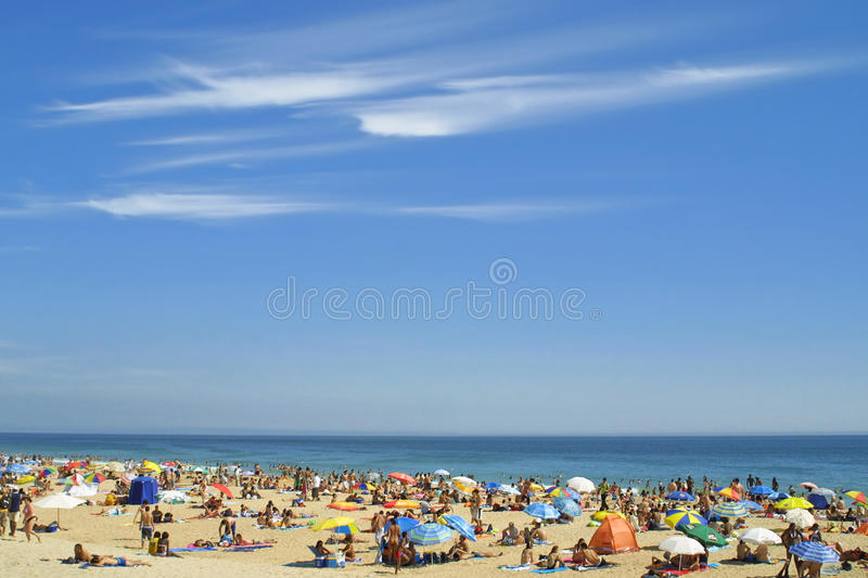 Crowded Atlantic beach. In Carcavelos, Portugal stock photos