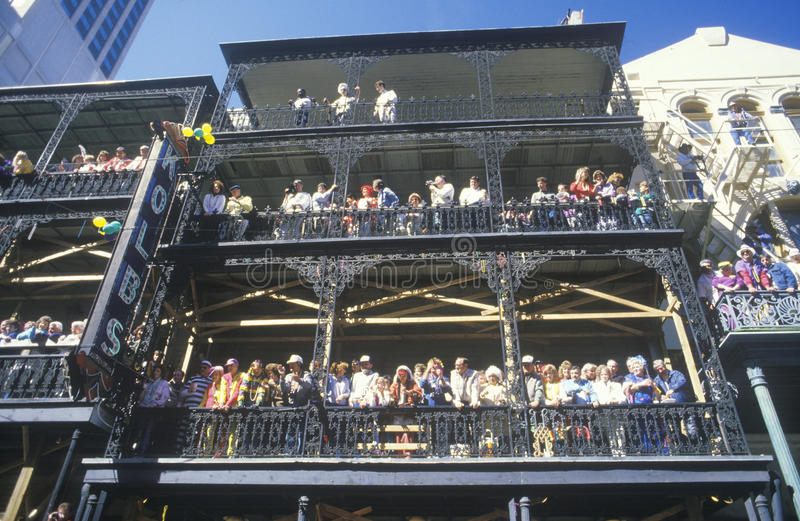 Crowded Balconies in French Quarter during Mardi Gras, New Orleans, Louisiana royalty free stock image