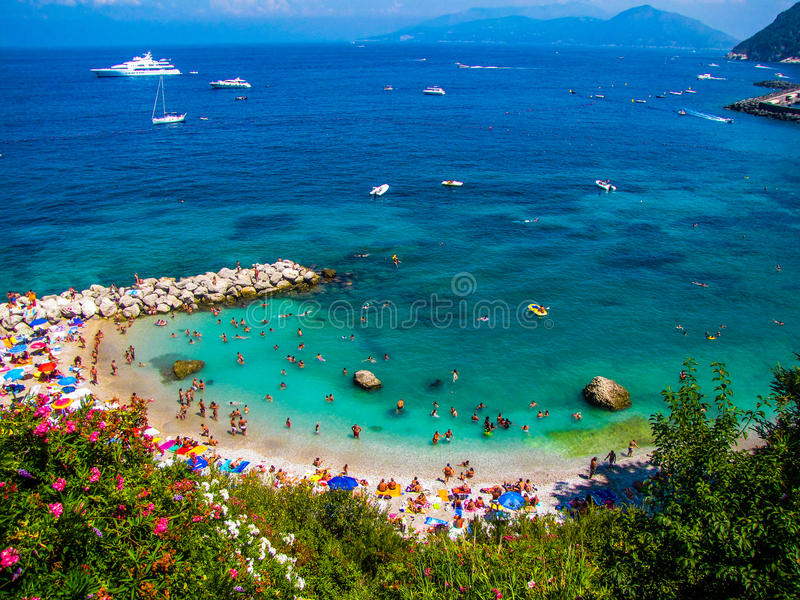 Crowded beach in Capri, Italy. An amazing, small crowded Italian beach in summer stock photos