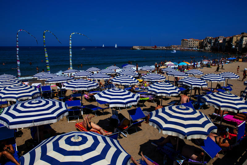 Crowded beach in Cefalu royalty free stock photo